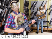 Купить «Male customers try on ammunition with weapon», фото № 26751262, снято 4 июля 2017 г. (c) Яков Филимонов / Фотобанк Лори