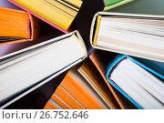 Купить «Multicolored books, top view», фото № 26752646, снято 22 июня 2017 г. (c) Елена Блохина / Фотобанк Лори