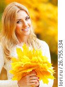 Купить «Smiling woman in autumn park», фото № 26755334, снято 10 октября 2013 г. (c) Иван Михайлов / Фотобанк Лори