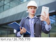 Купить «Businesswoman with documents touching screen tablet», фото № 26755770, снято 6 мая 2017 г. (c) Яков Филимонов / Фотобанк Лори