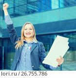 Employee glad woman standing with paper documents. Стоковое фото, фотограф Яков Филимонов / Фотобанк Лори