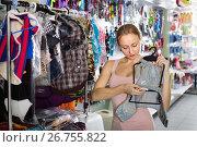 Купить «Female customer choosing clothes for dog», фото № 26755822, снято 9 апреля 2020 г. (c) Яков Филимонов / Фотобанк Лори