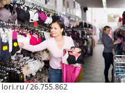 Laughing woman holding different brassiere. Стоковое фото, фотограф Яков Филимонов / Фотобанк Лори