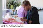 Купить «fashion designer with cloth making dress at studio», видеоролик № 26756758, снято 20 августа 2019 г. (c) Syda Productions / Фотобанк Лори