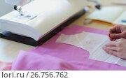 Купить «fashion designer with cloth making dress at studio», видеоролик № 26756762, снято 20 августа 2018 г. (c) Syda Productions / Фотобанк Лори