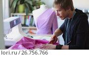 Купить «fashion designer with cloth making dress at studio», видеоролик № 26756766, снято 20 августа 2019 г. (c) Syda Productions / Фотобанк Лори
