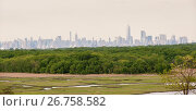 The Lower Manhattan skyline is seen from North Mound in Freshkills Park, formerly Freshkills Landfill, in Staten Island in New York. The landfill was officially... Стоковое фото, фотограф Richard Levine / age Fotostock / Фотобанк Лори