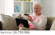 Купить «senior woman with tablet pc and credit card», видеоролик № 26759986, снято 20 октября 2018 г. (c) Syda Productions / Фотобанк Лори