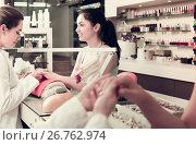 Купить «positive female manicurist filing and shaping nails in beauty salon», фото № 26762974, снято 28 апреля 2017 г. (c) Яков Филимонов / Фотобанк Лори
