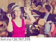 Купить «Young woman and man trying on fashion hats», фото № 26767318, снято 2 мая 2017 г. (c) Яков Филимонов / Фотобанк Лори