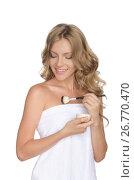 Купить «Beautiful woman moisturizing her skin with oil», фото № 26770470, снято 12 августа 2014 г. (c) Заметалов Андрей / Фотобанк Лори
