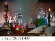 Купить «Magic potion, ancient books and candles on dark background», фото № 26771438, снято 19 августа 2017 г. (c) Майя Крученкова / Фотобанк Лори