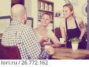 Купить «friendly waiter girl brought cup of coffee for couple of different aged people», фото № 26772162, снято 22 апреля 2017 г. (c) Яков Филимонов / Фотобанк Лори