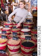Купить «woman taking dried beans», фото № 26772262, снято 15 ноября 2018 г. (c) Яков Филимонов / Фотобанк Лори