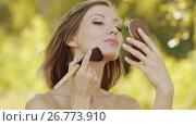 Купить «Young beautiful woman puts foundation on face», видеоролик № 26773910, снято 6 апреля 2016 г. (c) BestPhotoStudio / Фотобанк Лори