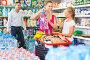 Smiling young woman and man with child choosing water, фото № 26785262, снято 11 июля 2017 г. (c) Яков Филимонов / Фотобанк Лори