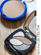 Купить «Women's cosmetics - powder and shadows in package», фото № 26793714, снято 26 декабря 2013 г. (c) Володина Ольга / Фотобанк Лори