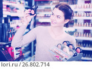 Купить «Seller demonstrating assortment», фото № 26802714, снято 21 февраля 2017 г. (c) Яков Филимонов / Фотобанк Лори