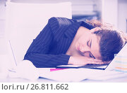 Купить «Woman worker is sleeping after productive day at work», фото № 26811662, снято 21 мая 2017 г. (c) Яков Филимонов / Фотобанк Лори