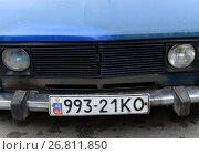 Купить «Жители Крыма заклеивают украинские автомобильные номера российской символикой», фото № 26811850, снято 18 сентября 2014 г. (c) Free Wind / Фотобанк Лори