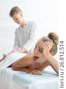Купить «View of massagyst massaging pretty girl in saloon», фото № 26812514, снято 31 июля 2017 г. (c) Гурьянов Андрей / Фотобанк Лори