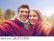 Купить «happy young couple taking selfie in autumn park», фото № 26813910, снято 9 октября 2016 г. (c) Syda Productions / Фотобанк Лори
