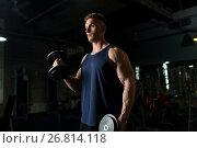 Купить «young man with dumbbells exercising in gym», фото № 26814118, снято 2 июля 2017 г. (c) Syda Productions / Фотобанк Лори