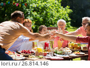 Купить «happy family having dinner or summer garden party», фото № 26814146, снято 9 июля 2017 г. (c) Syda Productions / Фотобанк Лори