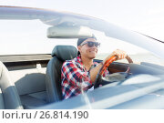 Купить «happy young man driving convertible car», фото № 26814190, снято 27 июля 2017 г. (c) Syda Productions / Фотобанк Лори