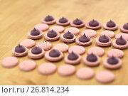 Купить «macarons on table at confectionery or bakery», фото № 26814234, снято 8 мая 2017 г. (c) Syda Productions / Фотобанк Лори