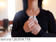 Купить «close up of woman with wipe at funeral in church», фото № 26814718, снято 20 марта 2017 г. (c) Syda Productions / Фотобанк Лори