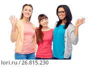 Купить «international group of happy women waving hands», фото № 26815230, снято 18 марта 2017 г. (c) Syda Productions / Фотобанк Лори