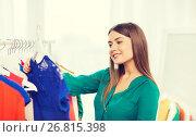 Купить «happy woman choosing clothes at home wardrobe», фото № 26815398, снято 19 февраля 2016 г. (c) Syda Productions / Фотобанк Лори