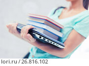 Купить «student with books, computer and folders», фото № 26816102, снято 1 июня 2013 г. (c) Syda Productions / Фотобанк Лори