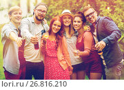 Купить «happy friends with drinks at summer garden party», фото № 26816210, снято 28 августа 2016 г. (c) Syda Productions / Фотобанк Лори