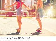 Купить «teenage couple riding skateboards on city street», фото № 26816354, снято 19 июля 2016 г. (c) Syda Productions / Фотобанк Лори