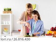 Купить «happy family cooking dinner at home kitchen», фото № 26816430, снято 26 марта 2017 г. (c) Syda Productions / Фотобанк Лори