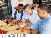 Купить «male friends with smartphone drinking beer at bar», фото № 26816454, снято 2 мая 2017 г. (c) Syda Productions / Фотобанк Лори