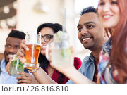 Купить «happy friends with drinks at restaurant», фото № 26816810, снято 2 мая 2017 г. (c) Syda Productions / Фотобанк Лори