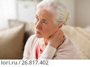 Купить «senior woman suffering from neck pain at home», фото № 26817402, снято 20 июня 2017 г. (c) Syda Productions / Фотобанк Лори