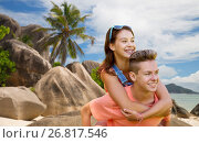 Купить «happy teenage couple having fun on summer beach», фото № 26817546, снято 19 июля 2016 г. (c) Syda Productions / Фотобанк Лори