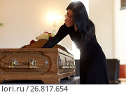 Купить «woman with coffin crying at funeral in church», фото № 26817654, снято 20 марта 2017 г. (c) Syda Productions / Фотобанк Лори