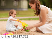 Купить «happy mother with baby girl playing in sandbox», фото № 26817762, снято 28 июля 2017 г. (c) Syda Productions / Фотобанк Лори