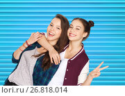 Купить «happy teenage girls hugging and showing peace sign», фото № 26818014, снято 19 декабря 2015 г. (c) Syda Productions / Фотобанк Лори
