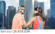 Купить «teenage couple with headphones on river berth», фото № 26818034, снято 19 июля 2016 г. (c) Syda Productions / Фотобанк Лори
