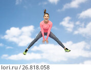 Купить «happy smiling sporty young woman jumping in sky», фото № 26818058, снято 22 декабря 2016 г. (c) Syda Productions / Фотобанк Лори