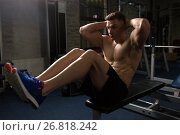 Купить «young man doing sit-up abdominal exercises in gym», фото № 26818242, снято 2 июля 2017 г. (c) Syda Productions / Фотобанк Лори