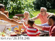 Купить «happy family having dinner or summer garden party», фото № 26818246, снято 9 июля 2017 г. (c) Syda Productions / Фотобанк Лори