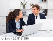 Купить «cheerful young man and charming woman coworkers talking in firm office», фото № 26818886, снято 31 мая 2020 г. (c) Яков Филимонов / Фотобанк Лори