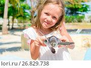 Купить «Adorable little girl with a small turtle in her hands in the natural reserve», фото № 26829738, снято 10 апреля 2017 г. (c) Дмитрий Травников / Фотобанк Лори